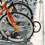 stock-photo-lots-of-bicycles-parked-at-a-two-levels-bike-rack-nearby-a-subway-station-in-singapore-urban-330931385