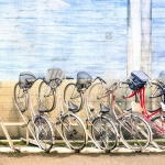 stock-photo-multicolored-vintage-bicycles-in-metal-rack-in-tokyo-city-urban-ecological-transportation-concept-257143453