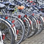 stock-photo-row-parked-bicycles-in-amsterdam-133337825